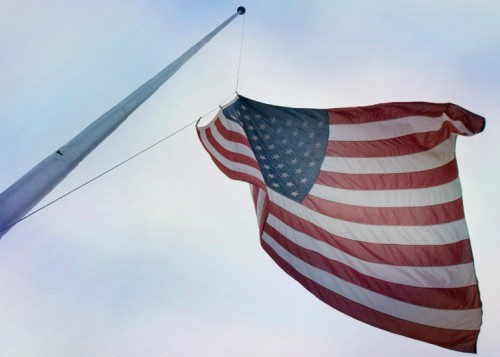 The American Flag being raised at Penn State's Old Main lawn.
